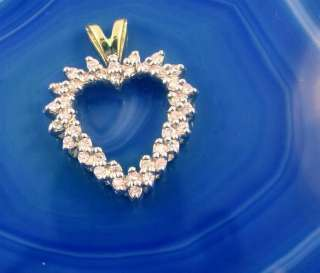 This is a wonderful 14kt YELLOW GOLD, (stamped), DIAMOND HEART PENDANT