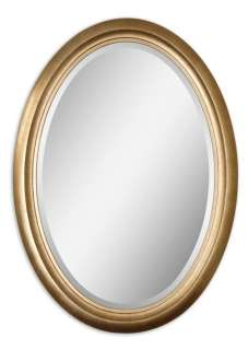 Antiqued gold leaf frame. Mirror has a generous 1 1/4 bevel.