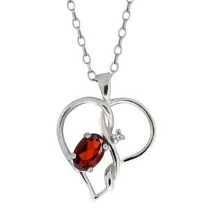 0.56 Ct Oval Red Garnet and White Diamond 18k White Gold