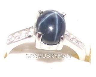 Amazing Natural and Genuine Blue Star Sapphire ring with Accents