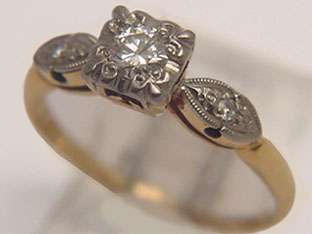 yellow and white gold diamond engagement ring set with one illusion