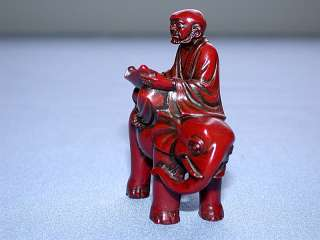 Red Lacquered Chinese Man on Elephant Reading Figurine