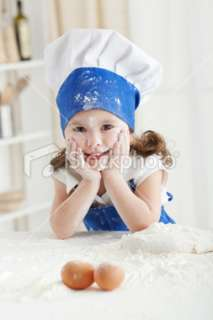 Sweet girl  little chef Royalty Free Stock Photo