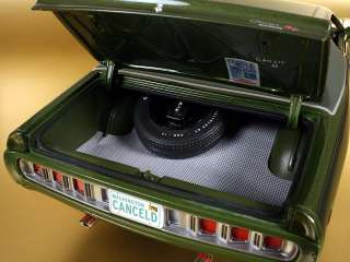 Trunk features full floor mat with mounted spare tire & jack. Detailed